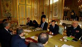 Lebanese Foreign Minister Gebran Bassil (2ndL) and French President Emmanuel Macron (2ndR) attend a