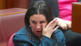 Jacqui Lambie, an independent and outspoken senator for the island state of Tasmania, reacts after d