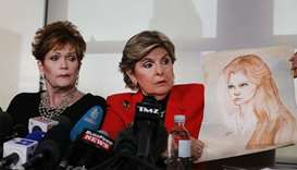 Lawyer Gloria Allred holds up a sketch of Beverly Young Nelson (L) when she was 16, at a news confer