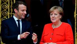 Merkel, Macron to front diplomatic push at UN climate talks
