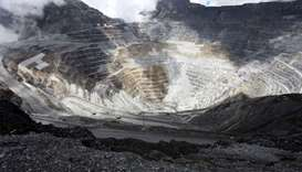 Trucks operate in the open-pit mine of PT Freeport's Grasberg copper and gold mine complex near Timi