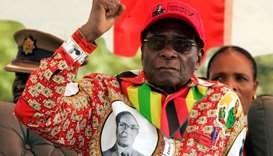 Robert Mugabe gestures at an election rally in the small town of Shamva northeast of the capital Har