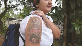 British woman wins compensation for Lanka deportation over tattoo
