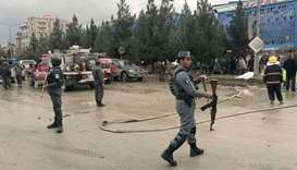 Afghan secuirty forces are seen at the site of an explosion in Kabul