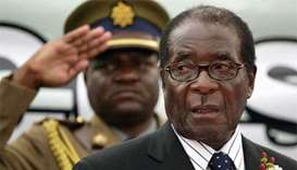 Mugabe under house arrest resists army pressure to quit