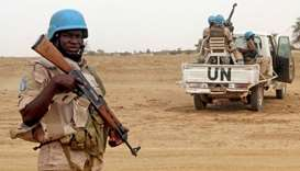 UN peacekeepers stand guard in the northern town of Kouroume, Mali