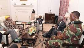 President Robert Mugabe (C) in a meeting with the ZDF Commander General Constantino Chiwenga, South