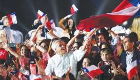 Chilean presidential candidate Sebastian Pinera waves a Chilean national flag during his final rally