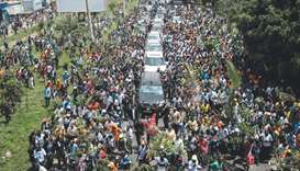 Supporters of Raila Odinga march with his convoy upon his arrival from the Jomo Kenyatta Internation