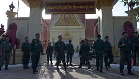 Cambodian police officials stand guard during a hearing in front of the Supreme Court building in Ph
