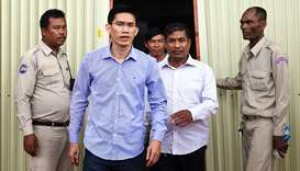 Yeang Sothearin, (C) being led away by the police