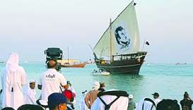 The sail of the dhow features a huge Tamim Al Majd image