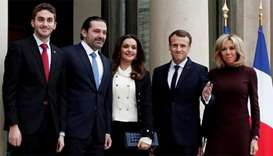 French President Emmanuel Macron and his wife Brigitte Macron, Saad al-Hariri, who announced his res