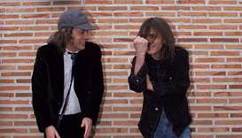 (This file photo taken on March 22, 2000 shows Australian guitarists and brothers Angus (left) and M