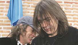 In this file picture, Australian guitarists and brothers Angus (left) and Malcolm Young of the hard