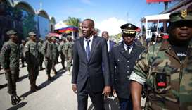Haitian President Jovenel Moise (C) and acting Chief of the army's high command Jodel Lesage inspect