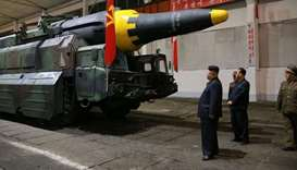 North Korean leader Kim Jong Un inspects a long-range strategic ballistic rocket. File picture