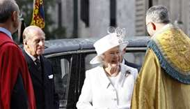 Britain's Queen Elizabeth II (2nd R) and Prince Philip (2nd L) arrive at Westminster Abbey in centra