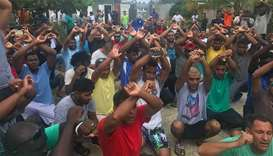 Refugees gesturing inside the Manus detention camp in Papua New Guinea