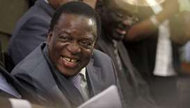 Emmerson Mnangagwa listens as President Robert Mugabe (not pictured) delivers his state of the natio