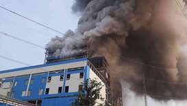 Smoke billows from a coal-fired power plant after a boiler unit exploded in the town of Unchahar