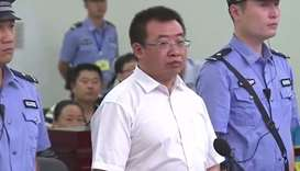 Chinese rights lawyer Jiang Tianyong (C) appearing in court in Changsha in China's central Hunan pro