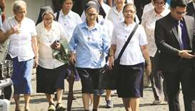Nuns enter the Supreme Court's compound to attend the start of the oral arguments on the  consolidat