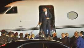 Lebanese Prime Minister Saad Hariri (C) arrives at Beirut International Airport late yesterday.