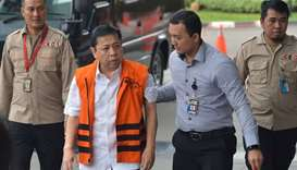Indonesian parliament speaker, Setya Novanto (2nd L), walks as he arrives at the Corruption Eradicat