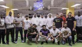 Qatar's Strongest Man 2017 competitors are seen with officials