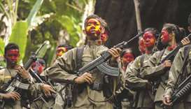 File photo shows guerrillas of the New People's Army (NPA) in formation in the Sierra Madre mountain