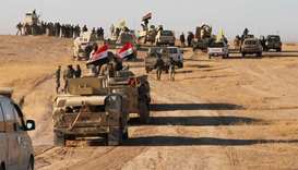 Iraqi forces, supported by members of the Hashed al-Shaabi, advance in the western desert in the nor