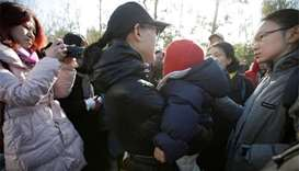 China probes preschool after 'needle marks' on toddlers