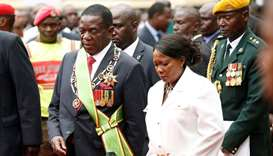 Zimbabwe's new president Emmerson Mnangagwa walks with his wife Auxillia after the swearing in cerem