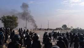 Pakistani riot police face off with protesters of the Tehreek-i-Labaik Yah Rasool Allah Pakistan (TL