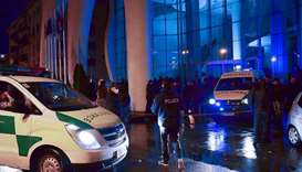 Police investigators and ambulance vans are seen in front of the Leogrand hotel in Georgia's Black S