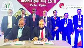 Board member Dr Mohamed Gohar al-Mohamed signs the agreement with the United World Halal Development