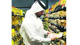 An inspector from the MEC going through some of the products stocked at an outlet