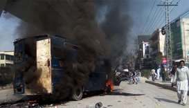 a burning prison van torched by protesters from the Tehreek-i-Labaik Yah Rasool Allah Pakistan (TLYR