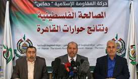 Hamas' senior political leader, Khalil al-Hayya (C) accompanied by Hamas spokesman Fawzi Barhoum (R)