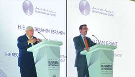 Dr. Ibrahim Ibrahim, Emiri Diwan economic adviser (L) and William Grant, US Ambassador (L) speak
