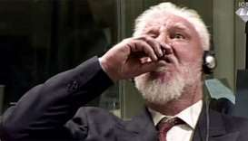 Dutch probe Bosnian war criminal's live UN court suicide