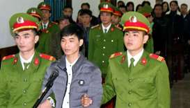 Activist Nguyen Van Hoa (C) standing trial at a local people's court in the central province of Ha T