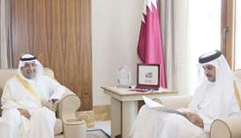HE Ambassador of the State of Kuwait to the State of Qatar Hafeez Mohammed Salem Al Ajmi handing ove