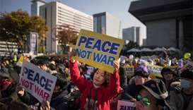 South Koreans urge peace in anti-Trump protest