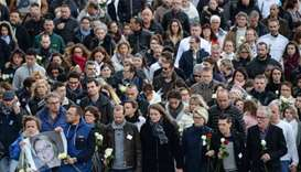 The relatives of Alexia Daval take part in a silent march gathering more than 8000 people in Gray
