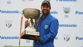 Indian golfer Shiv Kapur poses with the winning trophy
