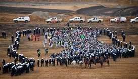 Policemen encircle environmentalists who managed to enter the Hambach lignite open pit mine near Els