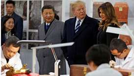 US President Donald Trump (back 2nd R), First Lady Melania Trump (back R) and China's President Xi J