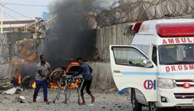 Somali rescue workers carry a man injured from the explosion in Mogadishu